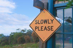 slowly sign